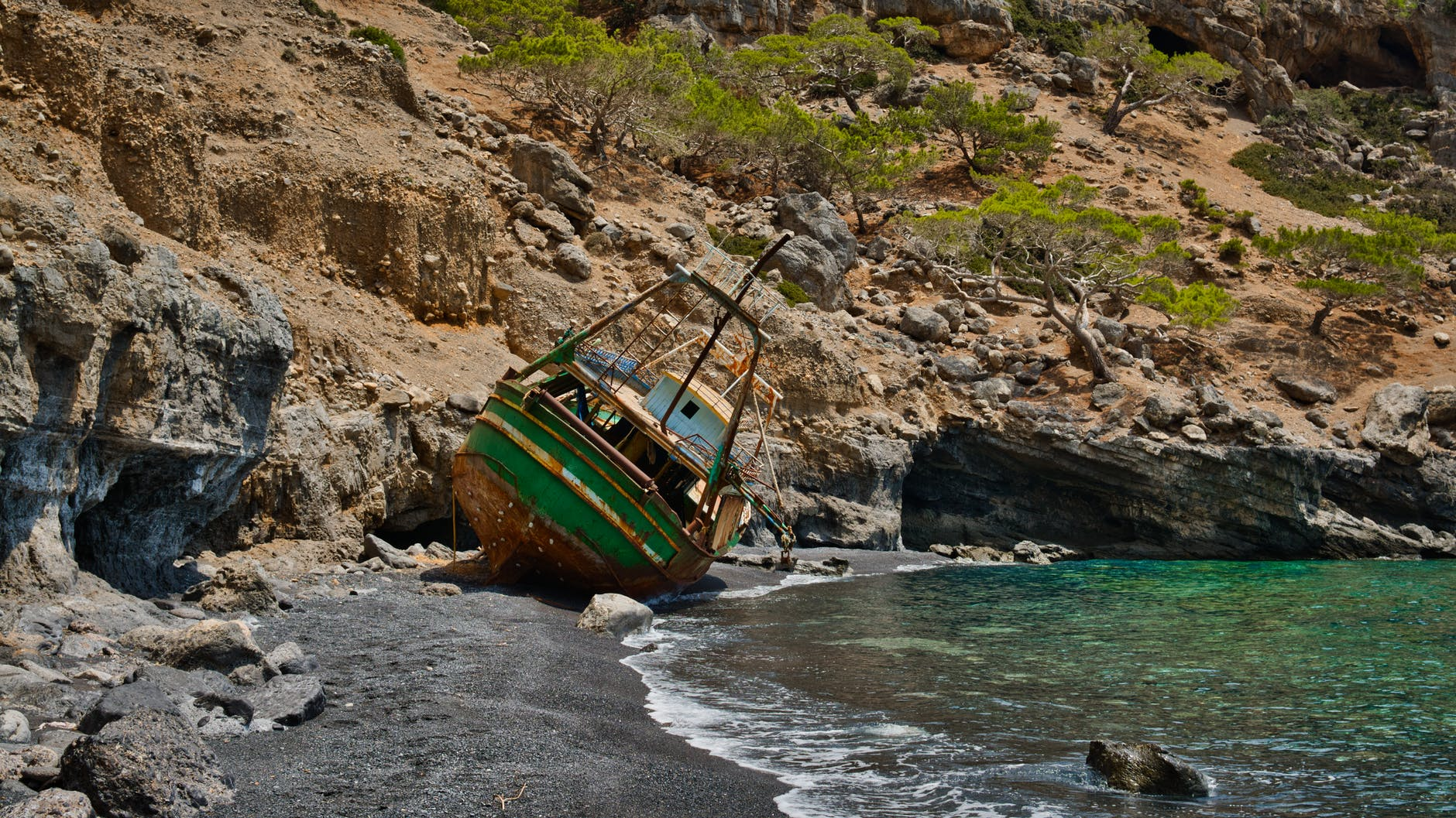 wreck fishing boat at the seashore